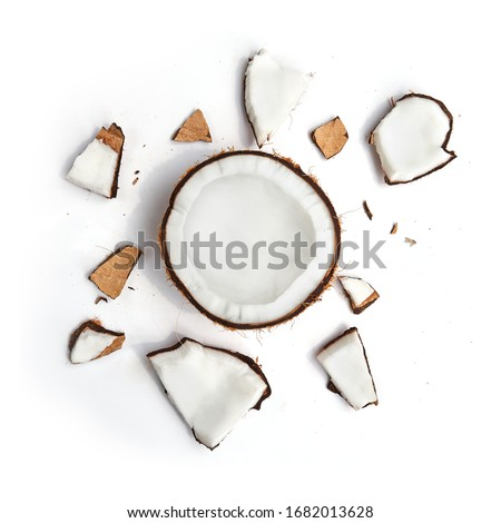 Whole coconut and pieces of coconut on white background Royalty-Free Stock Photo #1682013628