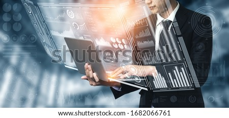 Big Data Technology for Business Finance Analytic Concept. Modern graphic interface shows massive information of business sale report, profit chart and stock market trends analysis on screen monitor. #1682066761