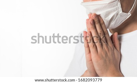 Side view of sick patient with medical mask praying #1682093779