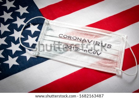 CORONAVIRUS. Protective medical mask on the background of the American flag . Concept of protection against coronavirus #1682163487
