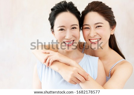 Portrait of smiling mother and daughter Royalty-Free Stock Photo #1682178577
