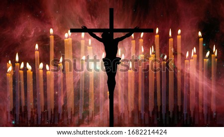 "Cross (Jesus Christ) and burning candles on the background The Sword of Orion ""Elements of this image furnished by NASA"