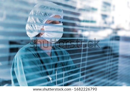 Doctor is looking away with, worry, frustration, tiredness and exhausting deep feelings.