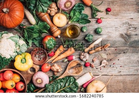 Organic food. Harvest of fresh vegetables on wooden background. Top view. Copy space. Diet or vegetarian food concept. Assortment of churd, pumpkin, carrot, pepper, cabbage, garlic, tomatoes. #1682240785