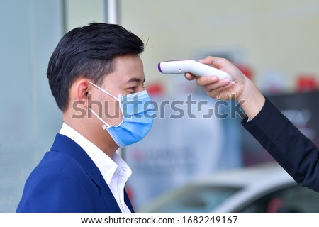 Body temperature check, prevent virus Concepts in preventing contagious diseases. Corona virus [Covid-19] Wash your hands with an alcohol gel to kill bacteria. Medical infrared thermometer use body. Royalty-Free Stock Photo #1682249167