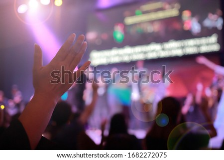 Picture blur effect./Worship God on Sunday with joy./Concert in low light and lens flare.