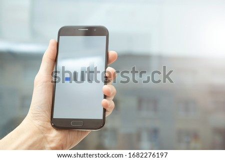 Bad or low mobile signal. Cell phone in hand. Network coverage.  Royalty-Free Stock Photo #1682276197