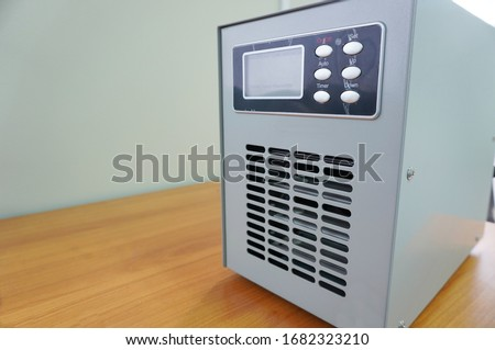 Ozone generators placed on the table in office room to cleaning and disinfection during corona-virus epidemic. (Covid 19) Royalty-Free Stock Photo #1682323210