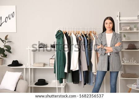Young female clothes stylist at workplace Royalty-Free Stock Photo #1682356537