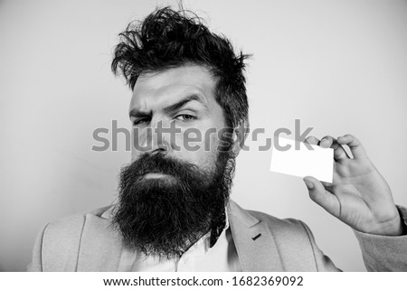 Proud of myself. best barber master. barber shop for gentlemen. brutal male beauty. serious bearded man business card. copy space. confident mature businessman. blank paper piece. barbershop concept.