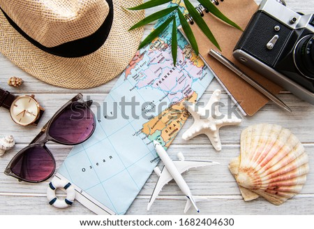 Overhead view of Traveler's accessories. Essential vacation items. Travel concept background. Flat lay Royalty-Free Stock Photo #1682404630