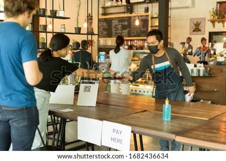 Social distance conceptual small business waiter serving customer in cafe. #1682436634