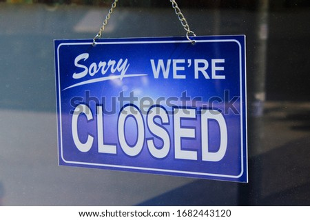 Sign outside of a closed shop due to Coronavirus outbreak. #1682443120