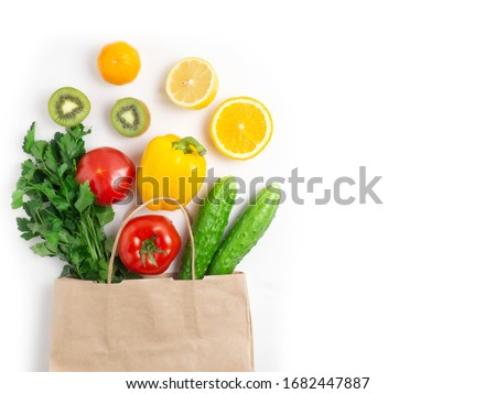 Various vegetables and fruits in the bag on a white background, top view, laid out in a circle. The concept of healthy eating, food background. #1682447887