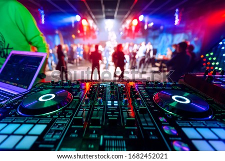 professional DJ music mixer at a party at an electronic music concert Royalty-Free Stock Photo #1682452021
