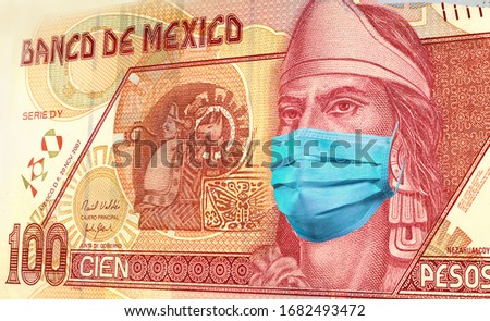100 peso banknote of Mexico with medical mask. of the coronavirus epidemic in Mexico. the impact of the coronavirus epidemic on the economy of Mexico and the currency of Mexico #1682493472