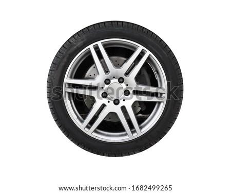 Shiny new car wheel isolated on white background Royalty-Free Stock Photo #1682499265
