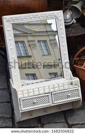 old white mirror on a flea market