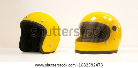 Yellow motorcycle Full helmet and Open face helmet on a white background Royalty-Free Stock Photo #1682582473