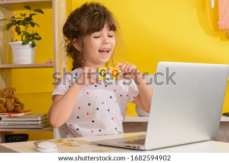 Children learn english online at home. Homeschooling and distance education for kids. Girl student study online with video call teacher.  Royalty-Free Stock Photo #1682594902