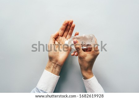Top view on elegant hands using antiseptic gel to disinfect hands. Precautions during the epidemic. Royalty-Free Stock Photo #1682619928