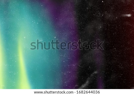 Designed film texture background with heavy grain, dust and a light leak Real Lens Flare Shot in Studio over Black Background. Easy to add as Overlay or Screen Filter over Photos overlay Royalty-Free Stock Photo #1682644036