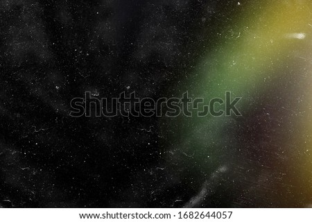 Designed film texture background with heavy grain, dust and a light leak Real Lens Flare Shot in Studio over Black Background. Easy to add as Overlay or Screen Filter over Photos overlay Royalty-Free Stock Photo #1682644057