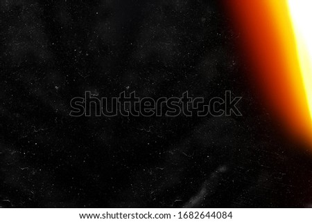 Designed film texture background with heavy grain, dust and a light leak Real Lens Flare Shot in Studio over Black Background. Easy to add as Overlay or Screen Filter over Photos overlay Royalty-Free Stock Photo #1682644084