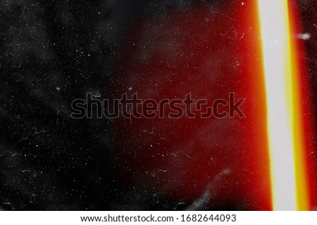 Designed film texture background with heavy grain, dust and a light leak Real Lens Flare Shot in Studio over Black Background. Easy to add as Overlay or Screen Filter over Photos overlay Royalty-Free Stock Photo #1682644093