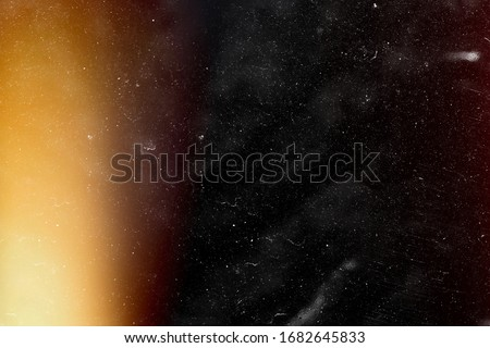 Designed film texture background with heavy grain, dust and a light leak Real Lens Flare Shot in Studio over Black Background. Easy to add as Overlay or Screen Filter over Photos overlay #1682645833