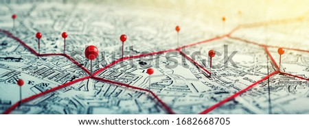 Routes with red pins on a city map. Concept on the  adventure, discovery, navigation, communication, logistics, geography, transport and travel topics. Royalty-Free Stock Photo #1682668705