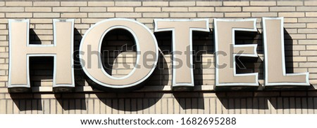 Hotel sign on a wall