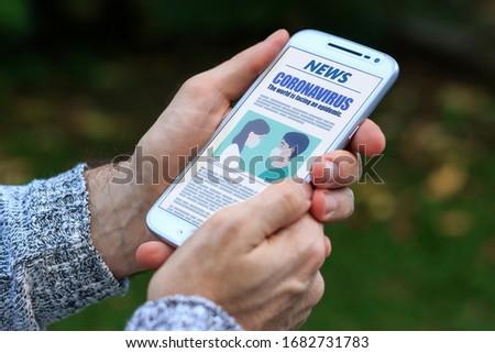 Coronavirus News. Man with smartphone in his hands reading about covid-19 virus. Online news in the screen of phone. Breaking News. #1682731783