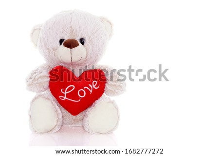 Teddy bear with a heart of love Royalty-Free Stock Photo #1682777272