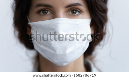 Close up portrait of young woman wear medical mask protecting from coronavirus pandemic, serious millennial female in protective face cover against spread of covid-19 virus, corona, epidemic concept #1682786719