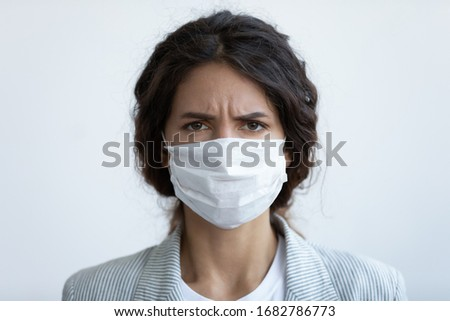 Close up headshot portrait of woman in protective medical mask from coronavirus feel anxious about pandemic, angry worried female wear face cover protecting from covid-19 corona epidemic #1682786773