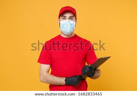 Delivery man in red cap blank t-shirt uniform sterile face mask gloves isolated on yellow background studio Guy employee working courier Service quarantine pandemic coronavirus virus concept #1682833465