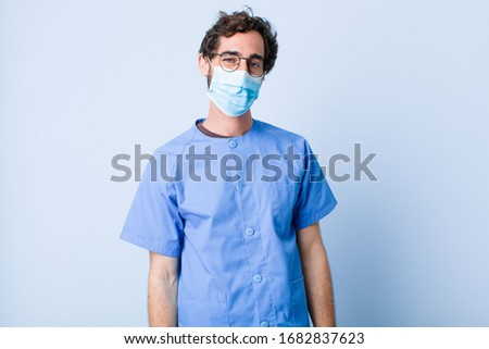 young man smiling positively and confidently, looking satisfied, friendly and happy. coronavirus concept #1682837623