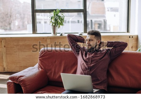 Young man working remotely at home #1682868973