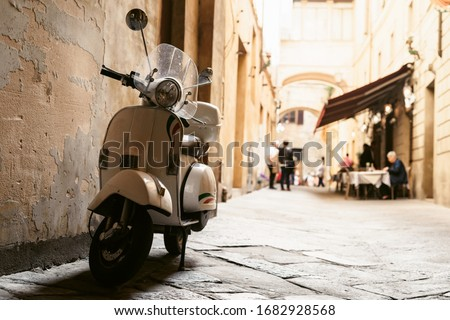 One of the most popular transport in Italy, vintage Vespa Royalty-Free Stock Photo #1682928568