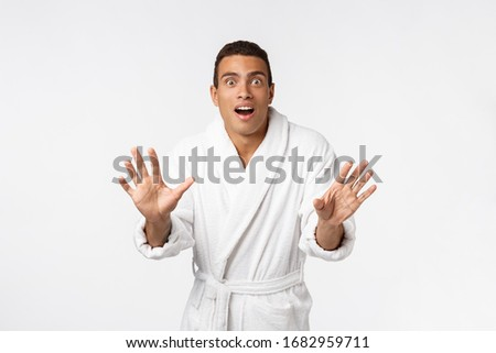 Hurray and cheers. Portrait of handsome shirtless young african american man looking excited while standing against white background #1682959711