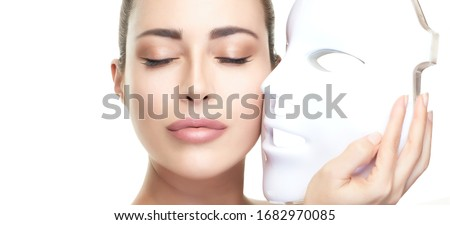Beauty and skin care concept. Healthy skin model woman with led mask. Photon therapy light treatment skin rejuvenation led facial mask. led skin rejuvenation therapy. Isolated on white with copy space #1682970085
