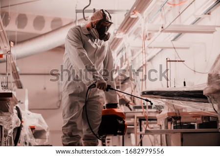 Coronavirus Quarantine. Disinfection and decontamination on a public place and factory as a prevention against Coronavirus disease 2019, COVID-19. State of emergency over pandemia with coronavirus. Royalty-Free Stock Photo #1682979556