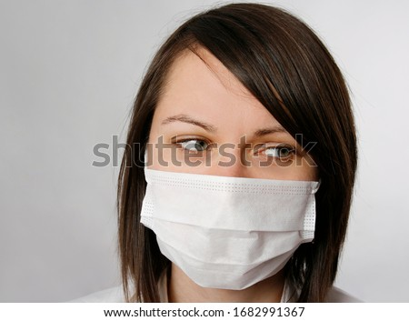 Young tired woman wearing a mask #1682991367