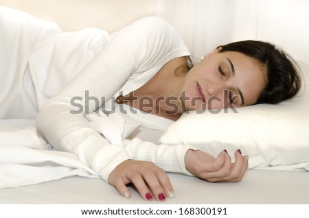Natural young woman sleeping between white sheets #168300191