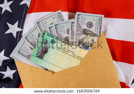 Senate stimulus deal includes individual checks virus economic stimulus plan USA dollar cash banknote on American flag Global pandemic Covid 19 lockdown Royalty-Free Stock Photo #1683006769