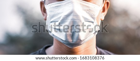 Man wearing protection face mask against coronavirus. 2019-nCoV virus infection in Wuhan city. Covid-19 ( SARS-CoV-2 ) spread around the world. #1683108376