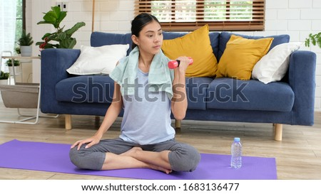 Exercise at home, Asian girl holding dumbbell for workout fitness, Healthy asia woman training weight fit sport for body strength, Female exercising in home living room, People wellness, well being #1683136477