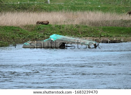 Sunk boat in a flooded river #1683239470