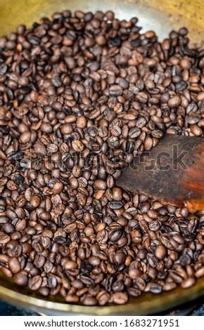 Roasting coffee bean in brass pan #1683271951